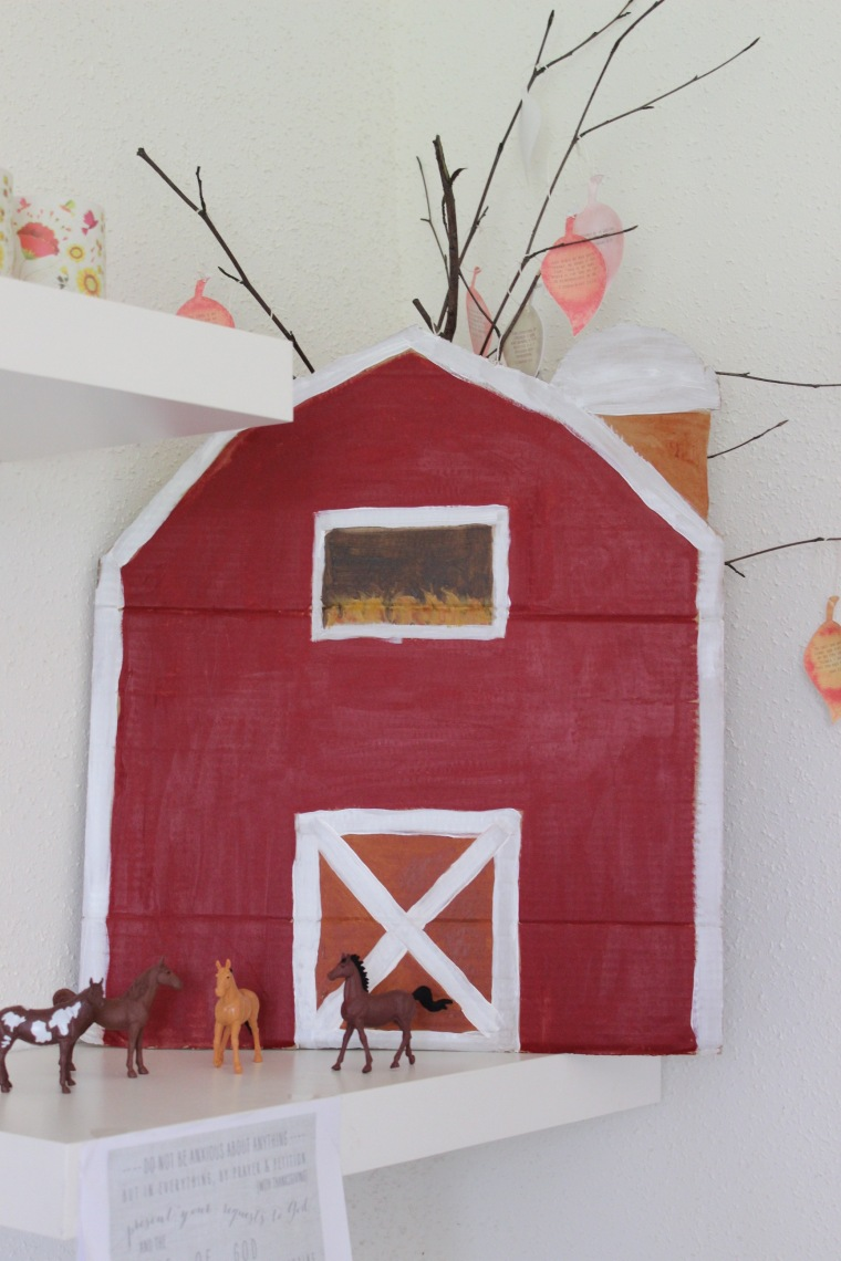 red cardboard barn turning two